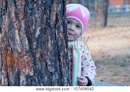 Cute Little Girl Playing Hide-and-seek