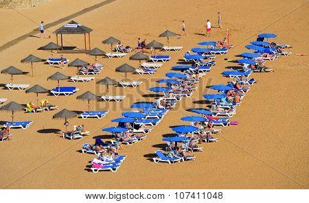 People enjoying the sun on Albufeira Beach