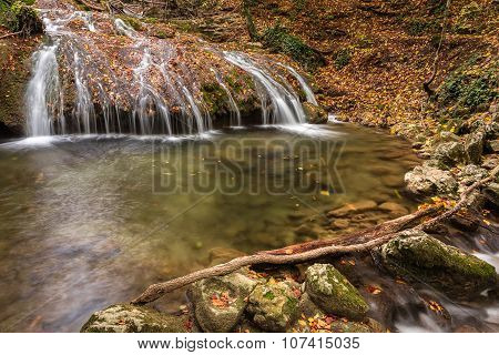 Beautiful River And Waterfall In The Autumn Forest