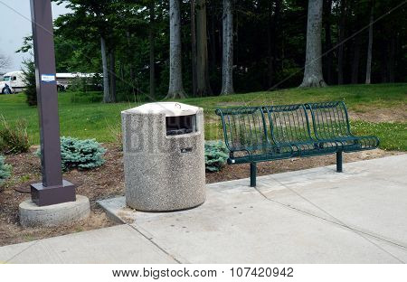 Garbage Can and Bench