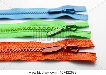 Colourful collection of zippers isolated on white