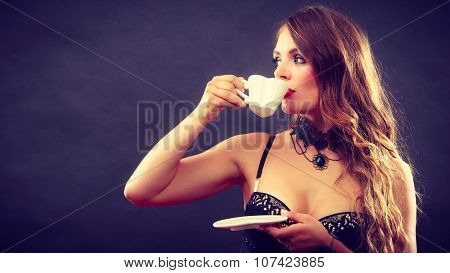 Model Wearing Lingerie With Beverage