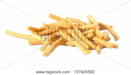 Golden Salted Crispy Breadsticks On A White Background