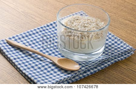 Yoghurt With Porridge Oats In Glass Cup