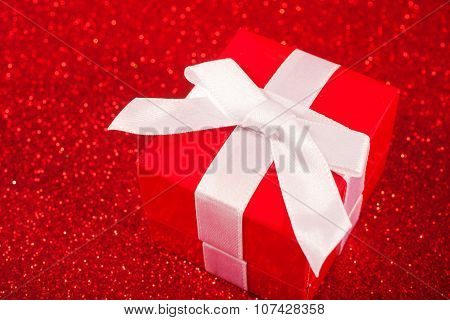 Red gift boxes on glitter red background