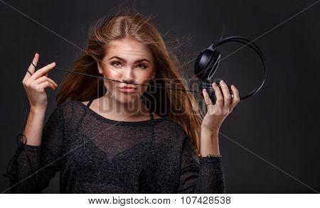 Girl Holding Headphones.