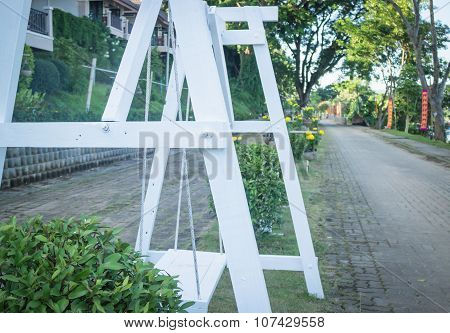 Vintage Wooden Swing Along The Pathway