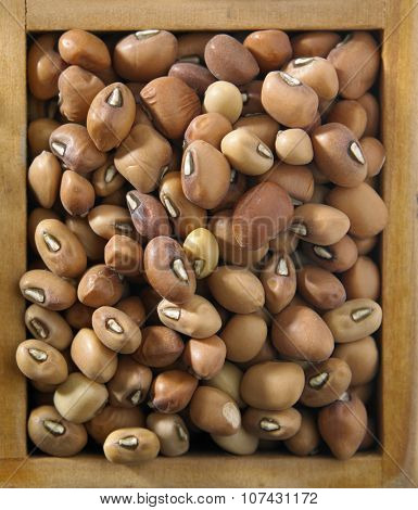 top view of Nigerian brown beans in a wooden container