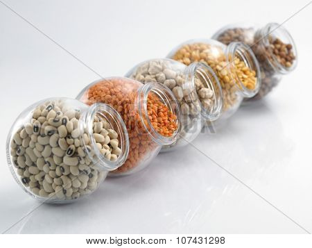 assorted beans arranged in a row