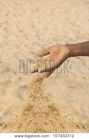 Man holding some sand in the hand: drought and desertification