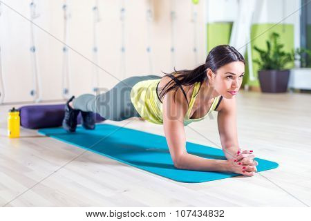 fitness training athletic sporty woman doing plank exercise in gym or yoga class concept exercising