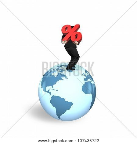 Businessman Carrying Percentage Sign Standing On Globe World Map