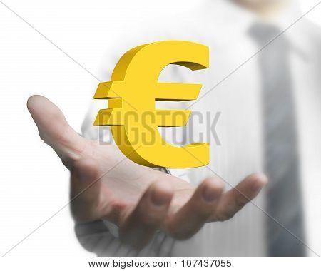 Businessman Hand Holding 3D Golden Euro Sign