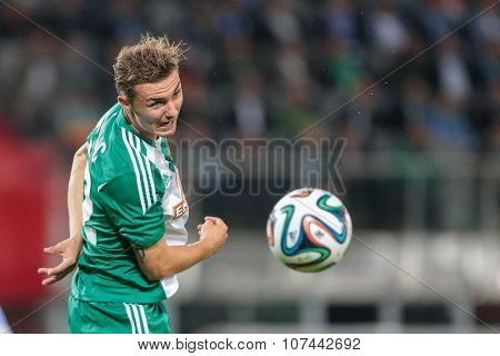 VIENNA, AUSTRIA - AUGUST 28, 2014: Mario Pavelic (#22 Rapid) heads the ball in an UEFA Europa League qualifying game.