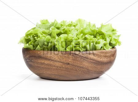 Fresh lettuce isolated on white background. Salad in a dish on a white background.
