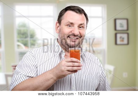Smiling guy is fond of vegetable smoothie diet
