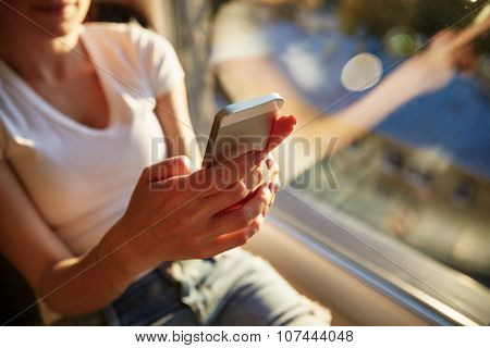 Young Casual Woman Using Smart Phone  At Home.