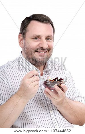 Smiling guy is fond of a beet salad