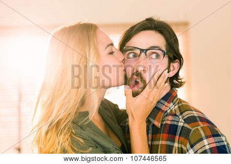 Pretty blonde kissing her co worker in casual office