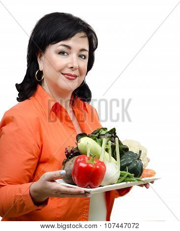 Smiling nutrition consultant with a tray of fresh vegetables