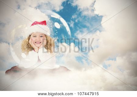 Festive child in snow globe against blue sky with white clouds