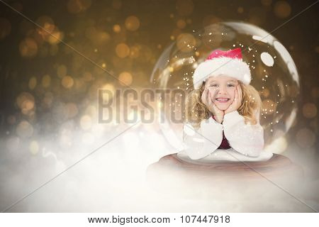 Festive child in snow globe against dark abstract light spot design