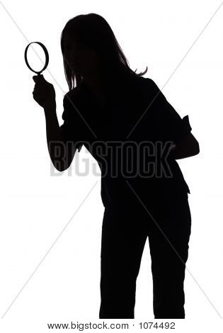 Silhouette Of Woman With Magnifying Glass