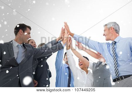 Business people doing hands checks against snow