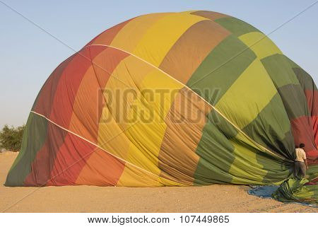 Hot Air Balloon Being Deflated On The Ground