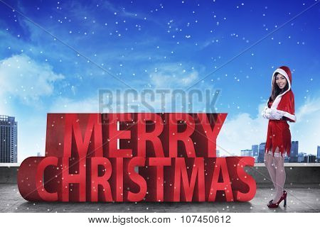 Pretty Asian Woman Standing With Merry Christmas 3D Text
