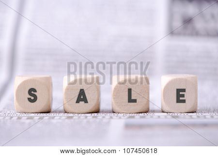 Four Dice With Sale Word Written On