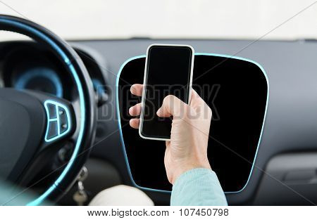 transport, business trip, technology and people concept - close up of male hand with smartphone driving car