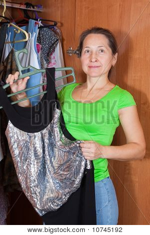 Woman Chooses Dress In Wardrobe