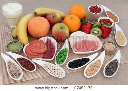 Body building health and super food with high protein meat, pulses, seeds, nuts, grains, supplement powders with whey milk shake.