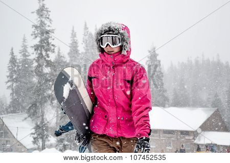 Young Woman Holding Snowboard