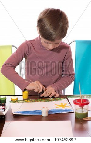 The Boy Drew A Water Color On A Paper A Brush