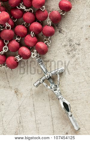 Silver Cross Crucifix On Old Canvas
