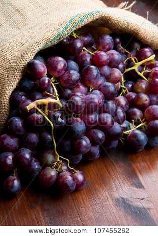 Bunch Black Grapes On Wooden Background