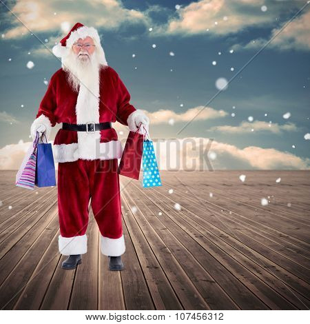 Santa carrying gifts against wooden planks leading to blue sky