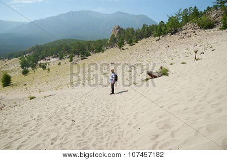 Sibaria,RU-July,27 2015:Lone Traveler In The Middle Of The Sand In Sunny Day. Sandy Bay, Lake Baikal