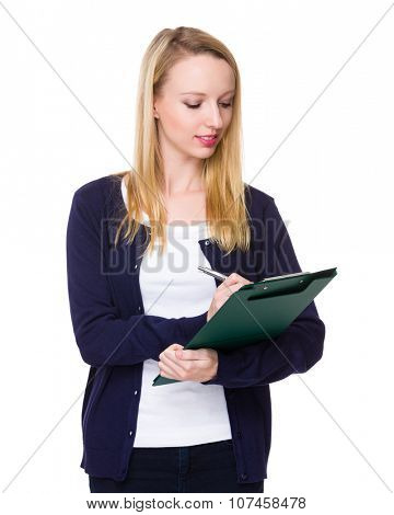 Caucasian young woman write on clipboard