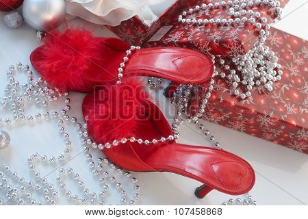Christmas still-life with red high heel slippers .