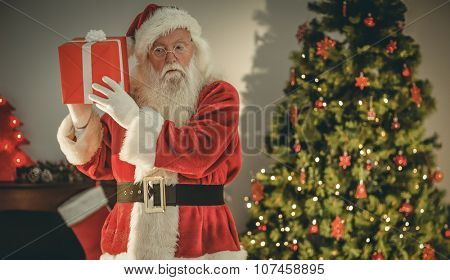 Father christmas delivering gift at christmas eve at home in the living room