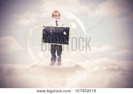 Festive child in snow globe against cloudy sky
