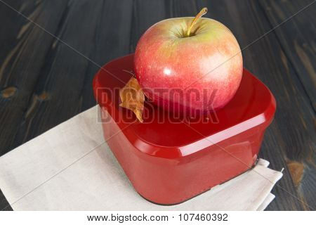 Red Apple And A Closed Box For School Lunch