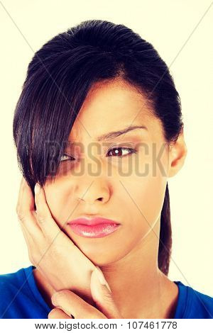 Portrait of woman with toothache