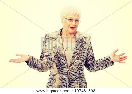 An old elegant lady having her hands spread