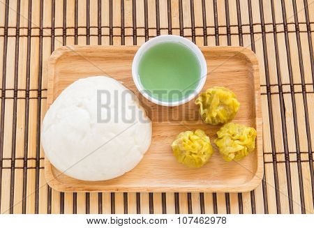 Chinese Buns And Dumpling In Wooden Plate