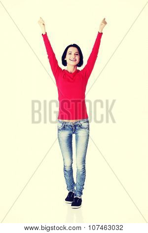 Excited young woman with fists up.
