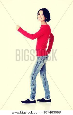 Side view of walking beautiful woman.